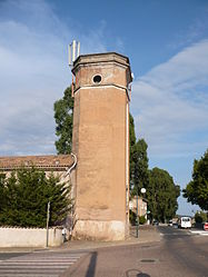 The tower of the FORTEF (Forces et Terres du Fium'orbu) of Migliacciaru, housing a clock and a siren to inform workers of the time, in Prunelli-di-Fiumorbo