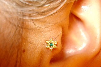 Tragus piercing of the tragus