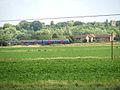 Train from King's Lynn approaching Watlington Station - geograph.org.uk - 1390486.jpg