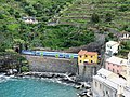 Train leaving Vernazza seen from the castle.jpg