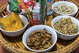 Tray with bowls of food including fried insects used in Lao cuisine.jpg