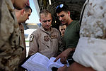 U.S. Air Force Airman 1st Class Andrew Poulisse, center left, a loadmaster assigned to the 14th Airlift Squadron out of Joint Base Charleston, S.C., and Marine Corps Sgt. Leo Parry, center right, a crew chief 100820-F-QA288-464.jpg