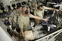 U.S. Air Force Lt. Col. Richard Degrosa, second from left, an emergency room doctor with the 86th Medical Group, instructs Airman to use a ultrasound machine in preparation for a simulated in-flight surgery 140117-F-RW714-517.jpg