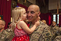 U.S. Army Staff Sgt. Frederick C. Abline, with the 508th Military Police Company, New Jersey Army National Guard, holds his daughter during a homecoming ceremony at the New Jersey National Guard Armory 130606-Z-AL508-003.jpg