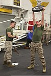 U.S. Marine Corps Cpl. Jonathan Yeager, left, monitors Lance Cpl. Collin Zaslov, both with the command element of the 24th Marine Expeditionary Unit, as Zaslov participates in the Warrior of the Month event 120501-M-RO494-016.jpg