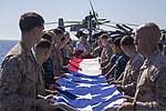 U.S. Marines and Sailors assigned to the 26th Marine Expeditionary Unit (MEU), and Sailors assigned to the USS Kearsarge (LHD 3), fold the American flag to commemorate the Fourth of July during their 2013 130704-M-BS001-010.jpg