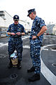 U.S. Navy Cmdr. Timothy Wilke, left, the outgoing commanding officer of the littoral combat ship USS Freedom (LCS 1), prepares to pass keys to Cmdr. Pat Thien, the incoming commanding officer of the ship 130806-N-YZ252-022.jpg