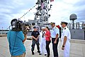U.S. Navy Lt. Cmdr. Michael D. Fortenberry, right, U.S. Coast Guard Rear Adm. Michael N. Parks, second from right, and U.S. Sailors conduct an interview with media on the pier in front of the patrol coastal ship 120809-N-YZ751-042.jpg