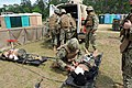 U.S. Sailors assigned to Naval Mobile Construction Battalion 11 participate in a mass casualty drill during a field exercise (FEX) at Camp Shelby, Miss., May 17, 2013 130517-N-UH337-027.jpg