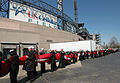 U.S. Sailors assigned to Navy Region Midwest, Navy Recruiting Chicago and Naval Station Great Lakes, Ill., carry a 300-foot-by-150-foot American flag around the outside of U.S. Cellular Field, Chicago, Ill. 080407-N-IK959-054.jpg