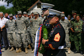 Operation Halyard - Marine Security Guards for the U.S. Embassy in Belgrade, Serbia Lance Aaron Johnston and Gunnery Sgt. Laureano Perez lay a wreath at the Halyard Mission memorial in Pranjani, Serbia.