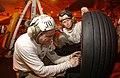 US Navy 020221-N-2722F-033 F-A-18 tire inspection aboard ship.jpg
