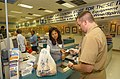 US Navy 020807-N-0872M-515 A Shopper pays for his purchase at one of the cashier counters inside the Navy Exchange located at Naval Base Little Creek.jpg