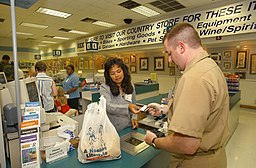US Navy 020807-N-0872M-515 A Shopper pays for his purchase at one of the cashier counters inside the Navy Exchange located at Naval Base Little Creek