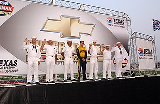 Jon Wood - Jon Wood joins sailors during a special pre-race reenlistment ceremony at Texas Motor Speedway Fort Worth, Texas, (September 13, 2002)