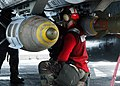 "US Navy 030325-N-9593M-006 An Aviation Ordnanceman assigned to the ""Tomcatters"" of Fighter Squadron Three One (VF-31) checks precision guided ordnance prior to the start of flight operations aboard USS Abraham Lincoln.jpg"