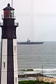US Navy 030505-N-5783F-001 Precommissioning Unit (PCU) Ronald Reagan (CVN 76) passes a lighthouse located at Fort Story Army Base.jpg