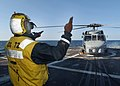 """US Navy 030609-N-4374S-002 The start-up signal is given to an MH-60B Seahawk helicopter assigned to the """"Proud Warriors"""" of Light Helicopter Antisubmarine Squadron Forty Two (HSL-42).jpg"""