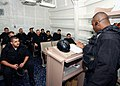 US Navy 040224-N-4374S-003 Members of the Vessel, Board, Search, and Seizure (VBSS) team assigned to the guided missile destroyer USS Roosevelt (DDG 80) conduct a safety brief prior to departing on a Maritime Interception Opera.jpg