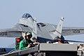US Navy 040417-N-4953E-001 Photographer's Mate 2nd Class John Beeman takes photos of flight deck operations as an F-14 Tomcat launches from the ship's flight deck.jpg