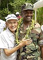 US Navy 040915-N-7293M-217 Commander, U.S. Naval Region Marianas Rear Adm. Arthur J. Johnson, meets and embraces former Japanese soldier Kiyokazu Tsuchida.jpg