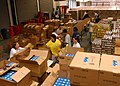 US Navy 040929-N-7912E-002 Sailors assigned to the amphibious assault ship USS Boxer (LHD 4), take time to give back to the community by helping the San Diego Food Bank pack boxes of food for needy families.jpg