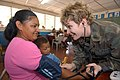 US Navy 050310-N-1159B-114 Lt. Cmdr. Lisa Kromanaker, a nurse assigned to Operational Health Support Unit Great Lakes, Ill., measures the blood pressure of a Nicaraguan woman during a Medical Readiness Training Exercise.jpg