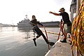 US Navy 050610-N-2385R-061 Aviation Boatswain's Mate 3rd Class Greg Early assists Operations Specialist 3rd Class Shane Olson, a diver assigned to Ships Repair Facility- Japan Regional Maintenance Center, Detachment Saseb.jpg