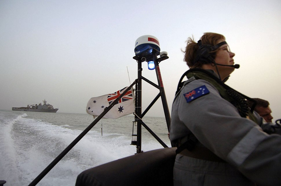 US Navy 050704-N-4309A-443 Australian Petty Officer ET Tarah Clark, stationed aboard the guided missile armed frigate HMAS Newcastle (FFG 06), drives a Rigid Hull Inflatible Boat (RHIB) back to her ship after making a passenger