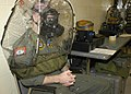 US Navy 050719-N-3207B-038 Aviation Warfare Systems Operator 1st Class Patrick Biddinger endures a series of tests to certify that his Chemical Biological Radiological gas mask properly fits.jpg