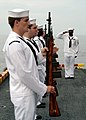 US Navy 050730-N-3666S-094 The honor guard aboard the amphibious assault ship USS Wasp (LHD 1) pays respect to a past shipmate during one of three burial at sea ceremonies held aboard the ship.jpg