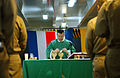 US Navy 060226-N-2959L-122 Navy Chaplain, Lt. Kenneth Medve, prepares for communion during Roman Catholic service in the foc'sle aboard the Nimitz-class aircraft carrier USS Ronald Reagan (CVN 76).jpg