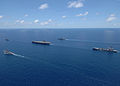 US Navy 060429-N-9621S-010 Ships assigned to the George Washington Carrier Strike group sail in formation during a strike group photo exercise.jpg