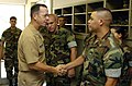 US Navy 060908-N-0696M-142 Chief of Naval Operations (CNO) Adm. Mike Mullen greets Equipment Operator 1st Class Anthony Alicea assigned to Naval Mobile Construction Battalion One Three Three (NMCB-133) after an all hands call.jpg
