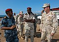 US Navy 061209-N-1328C-353 Commander, U.S. Naval Facilities Engineering Command Rear Adm. Richard E. Cellon speaks with Obock, Djibouti, city officials about a proposed pier project for Naval Mobile Construction Battalion Five.jpg