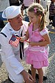US Navy 070529-N-8544C-033 Electronics Technician 1st Class David Couch greets his four-year-old daughter during the homecoming for guided-missile destroyer USS The Sullivans (DDG 68).jpg