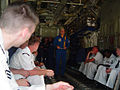 US Navy 070706-N-2888Q-001 Maj. Matt McGath briefs several Michigan recruiters before their flight on Fat Albert, the U.S. Marine Corps C-130 Hercules assigned to the Blue Angels.jpg