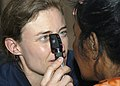 US Navy 070901-N-9195K-045 Cmdr. Elizabeth Satter performs an eye exam on a local woman during a medical civic action program held at Delap High School.jpg