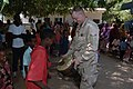 US Navy 071009-N-3931M-086 Personnel attached to Combined Joint Task Force-Horn of Africa (CJTF-HOA) and the U.S. Central Command Air Force Band interact with people from a local village following a concert performed by the ban.jpg
