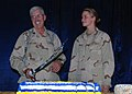 US Navy 071013-N-7415V-002 Cmdr. Francis Williams and Personnel Specialist 3rd Class Ashley Urbanski, the longest and shortest serving Sailors at Combined Security Transition Command-Afghanistan (CSTC-A), cut a cake.jpg
