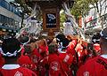 US Navy 071021-N-7446H-007 Sailors carry a Mikoshi through the streets of Yokosuka during the 31st Yokosuka Mikoshi Parade.jpg