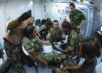 Santomean personnel undergo medical training with US Naval corpsmen US Navy 080123-N-4044H-052 Chief Hospital Corpsman Chris Maurer demonstrates to Sao Tomain military personnel the procedure for inserting an intravenous drip into a person's vein.jpg