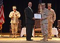 US Navy 080705-N-9167V-006 U.S. Ambassador to the Kingdom of Bahrain J. Adam Ereli, left, presents Vice Adm. Kevin Cosgriff with the Distinguished Service Medal.jpg