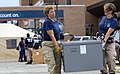 US Navy 080903-N-4154B-061 Two members from the FEMA Disaster Medical Assistance Team move boxes of equipment.jpg