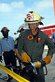 US Navy 081018-N-3289C-008 Capt. Bill Mosk cuts a ribbon with the Jaws of Life for the opening of a new fire fighting training center.jpg