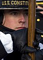 US Navy 081125-N-0167W-080 USS Constitution crewmember Seaman Josh Hanover carries the national ensign.jpg