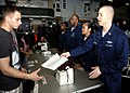 US Navy 090215-N-9520G-076 Hospital Corpsman 2nd Class Jason D. Moore hands out medical questionnaires to evacuees during a mock non-combatant evacuation operations drill aboard USS Essex (LHD 2).jpg