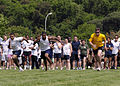 US Navy 090515-N-4044H-115 Competitors from various commands in the Naples area start the men's 100-meter dash during the 15th annual Armed Forces Olympics at Carney Park.jpg