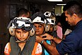 US Navy 090712-A-1333S-175 Nicaraguans patients are assisted by Sailors aboard the Military Sealift Command hospital ship USNS Comfort (T-AH 20) as they prepare to depart Comfort.jpg