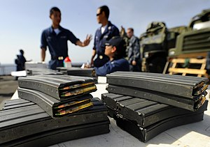 STANAG magazine - Image: US Navy 090930 N 5345W 078 Loaded magazines with 5.56mm rounds are ready for the M 16 M 4 weapons qualifications on the flight deck of the amphibious dock landing ship USS Fort Mc Henry (LSD 43)